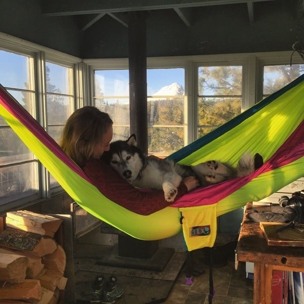 Girl in hammock with dog inside lookout
