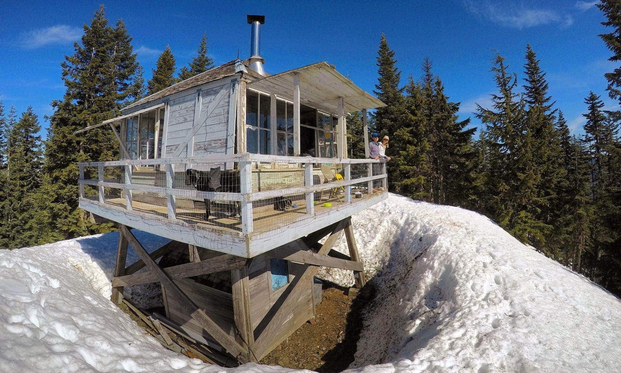 Bird's-eye view of Devils Peak fire lookout in snow