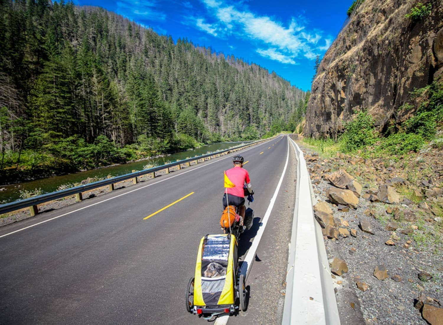 Cyclist towing dog on Cascading Rivers Scenic Bikeway
