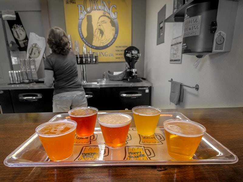 Taster tray at Boring Brewing, only the beer and sign edited in color, the rest black and white