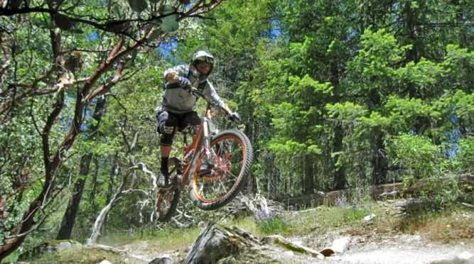 Mountain biker takes jump on Mt. Ashland.