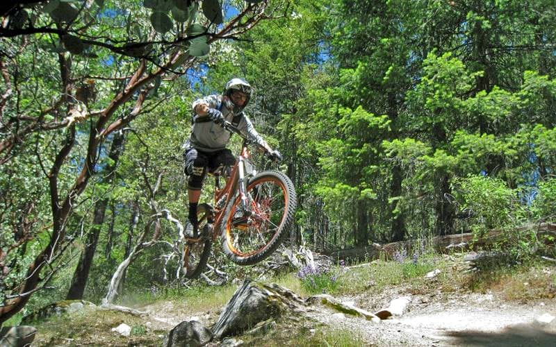 Mountain biker takes jump on Mt. Ashland.