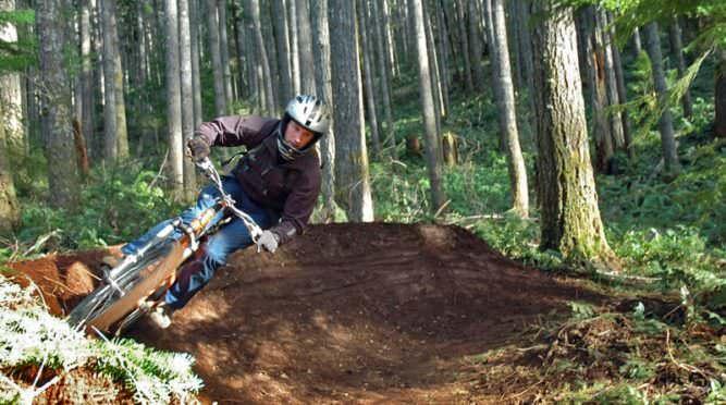 Mountain biker slides up a hill at Black Rock.