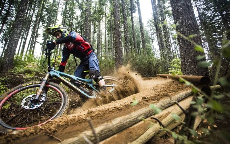 A low-to-the-ground view of a mountain biker seems to emphasize his speed.