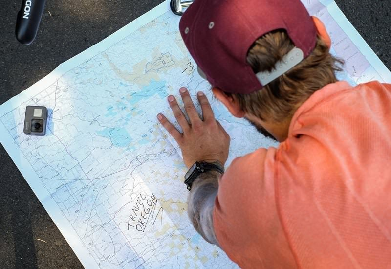 Man looks at map to figure out bikeway route.
