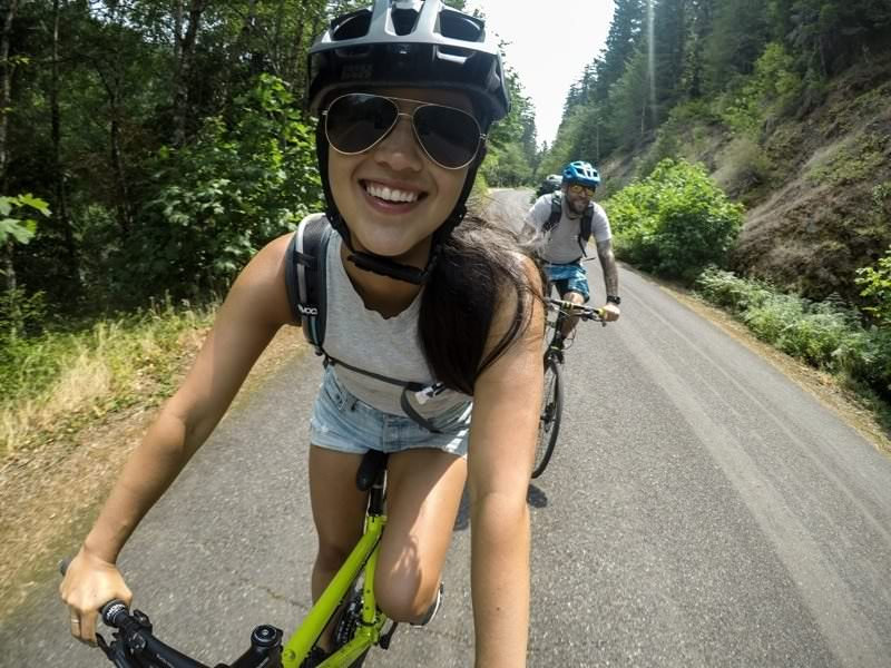 Selfie of bicyclists while riding.