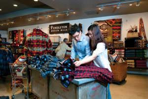 Shoppers inside Pendleton Woolen Mills