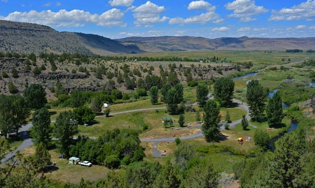 A bird's-eye view of Minam State Recreation Area reveals vast wilderness and campsites.