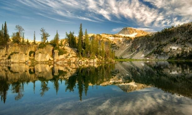 Mountains reflect on the aptly named Mirror Lake.