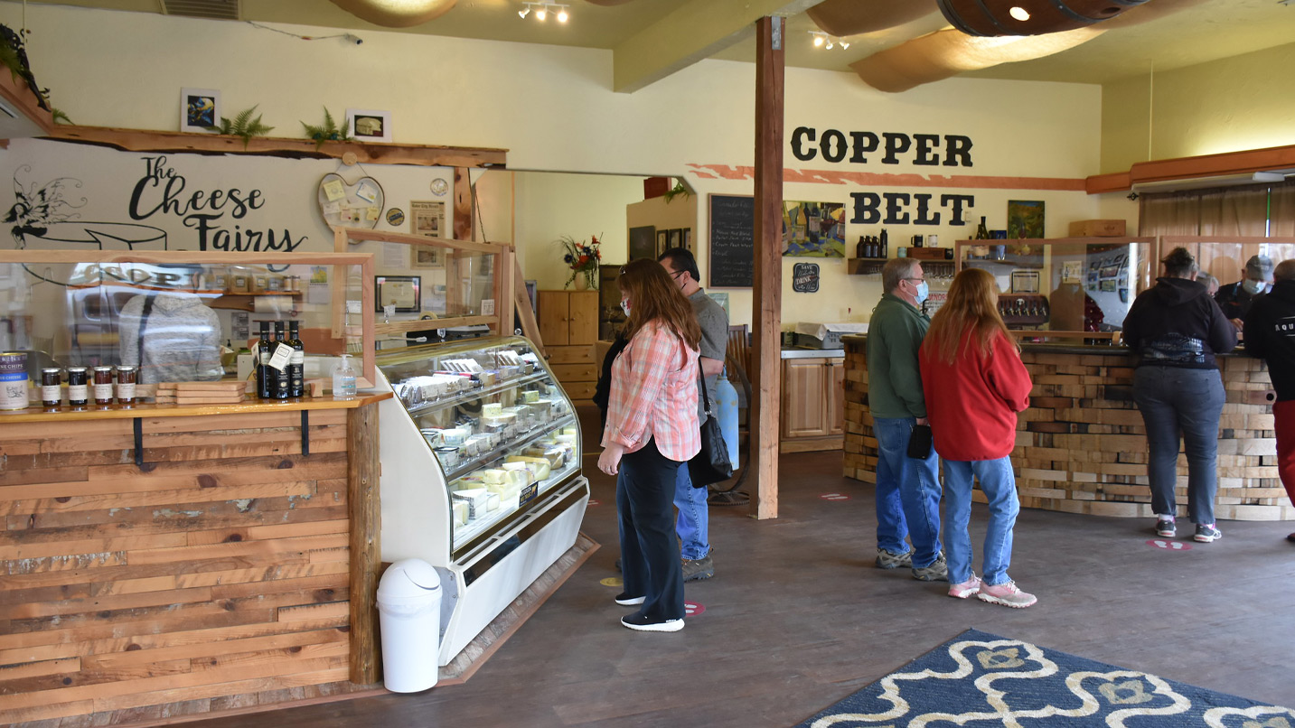 Customers mill about in a store