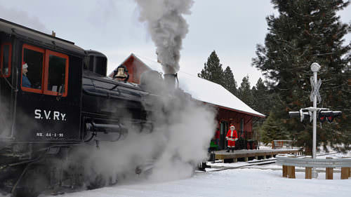 The snow-capped Elkhorn Mountains set the stage for the Sumpter Valley Railroad's two-hour vintage train ride. (Photo credit: Baker County Tourism)
