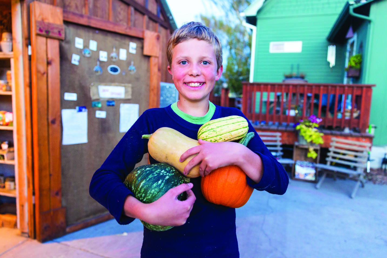 Kid holding gourds