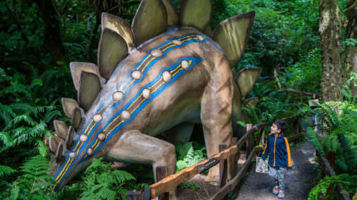 Stroll among the life-sized dinosaurs in a lush forest at Prehistoric Gardens (Photo credit: Gregor Halenda)