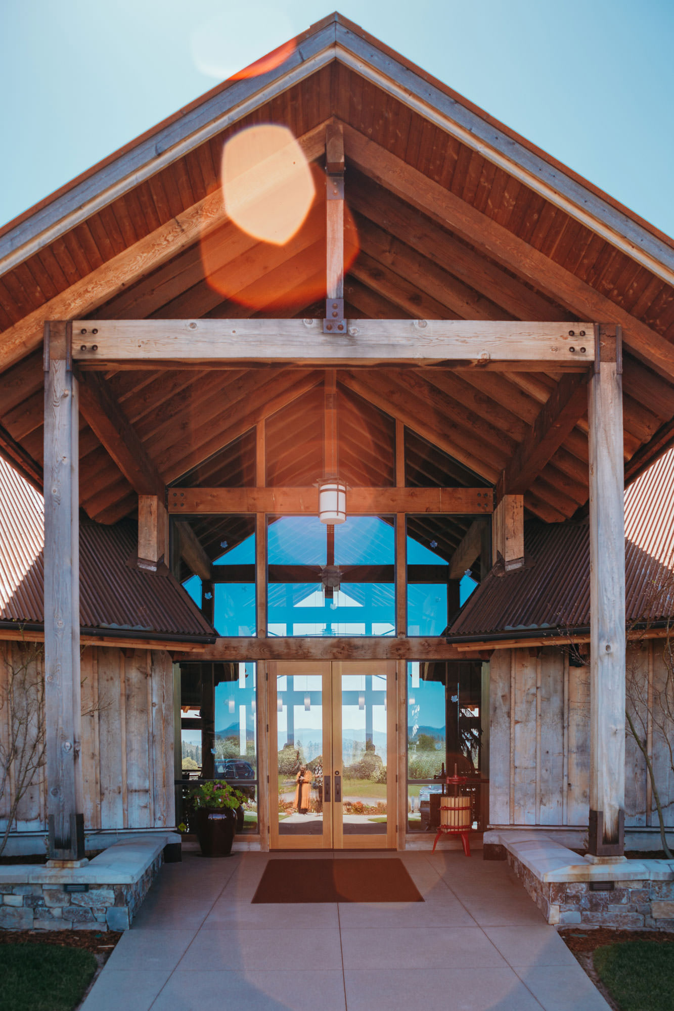 The tasting room for Kriselle Cellars is made of large beams and big windows.