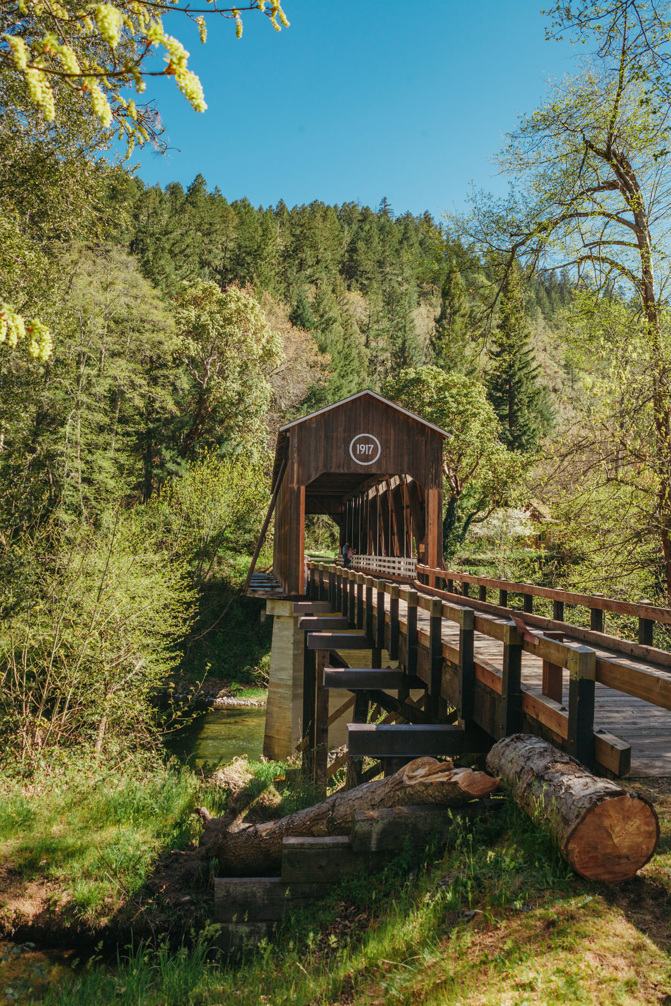 The McKee Covered Bridge is a charming wooden structure surrounded by trees.