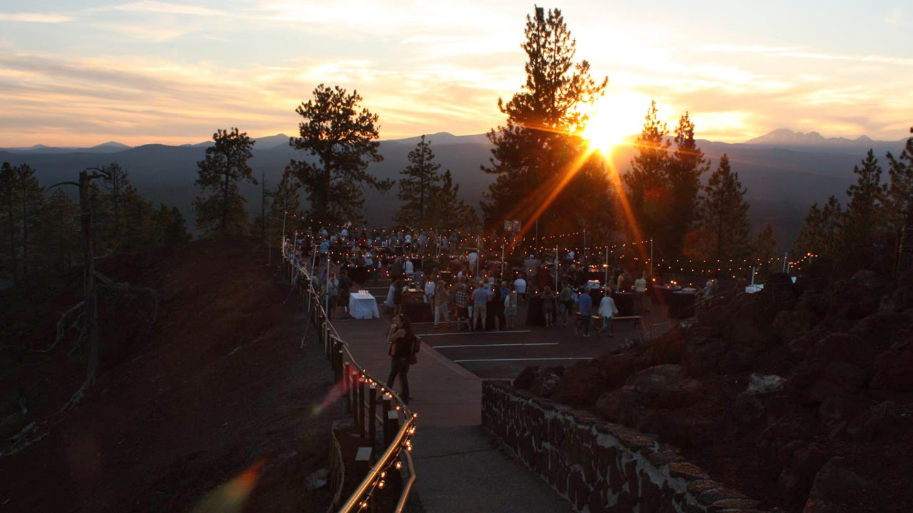 The sun sets over a cocktail party in the Newberry National Volcanic Monument.