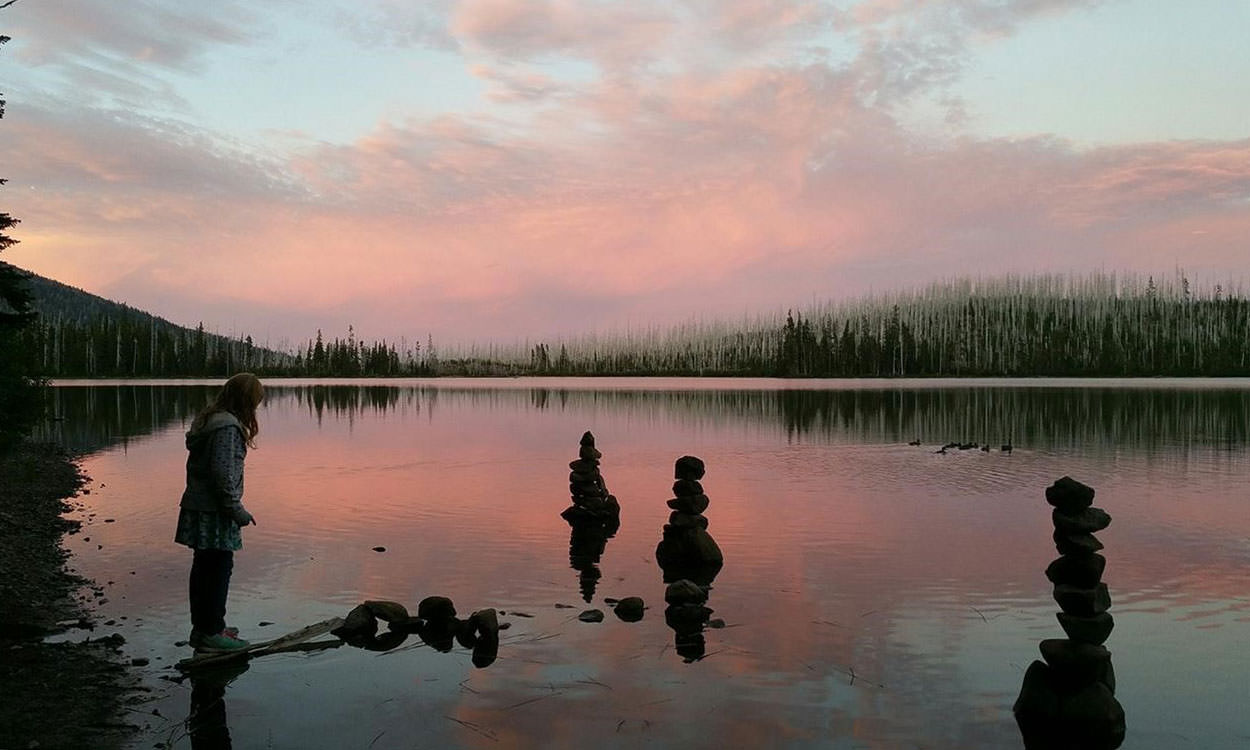 Peninsula Olallie Lake campground glows in a pink sunset.