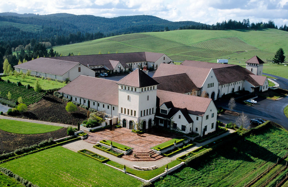 A bird's-eye view of King Estate reveals a sprawling vineyard property with European-style architecture.