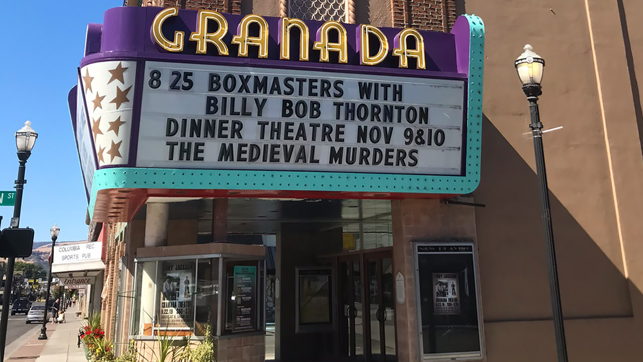 "The Granada Theatre sign shows upcoming events that include a dinner theatre, ""The Medieval Murders,"" in November."