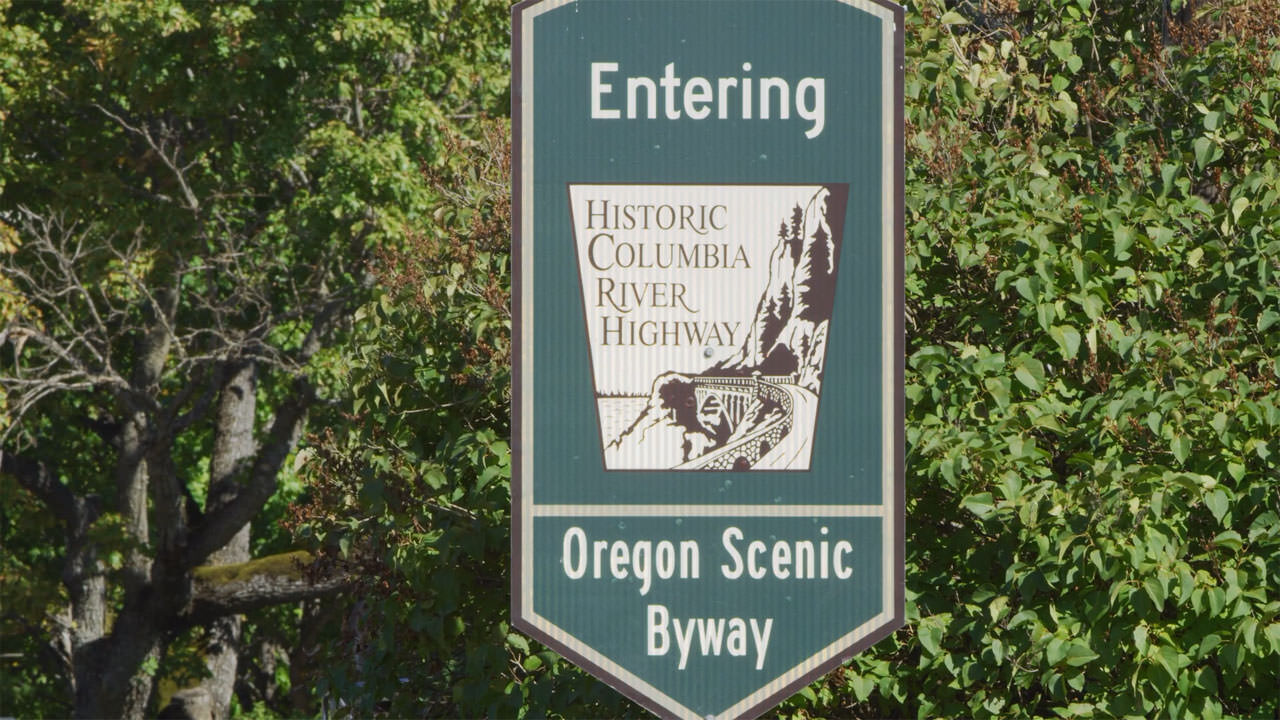 A sign denotes the Historic Columbia River Highway, a designated Oregon Scenic Byway.