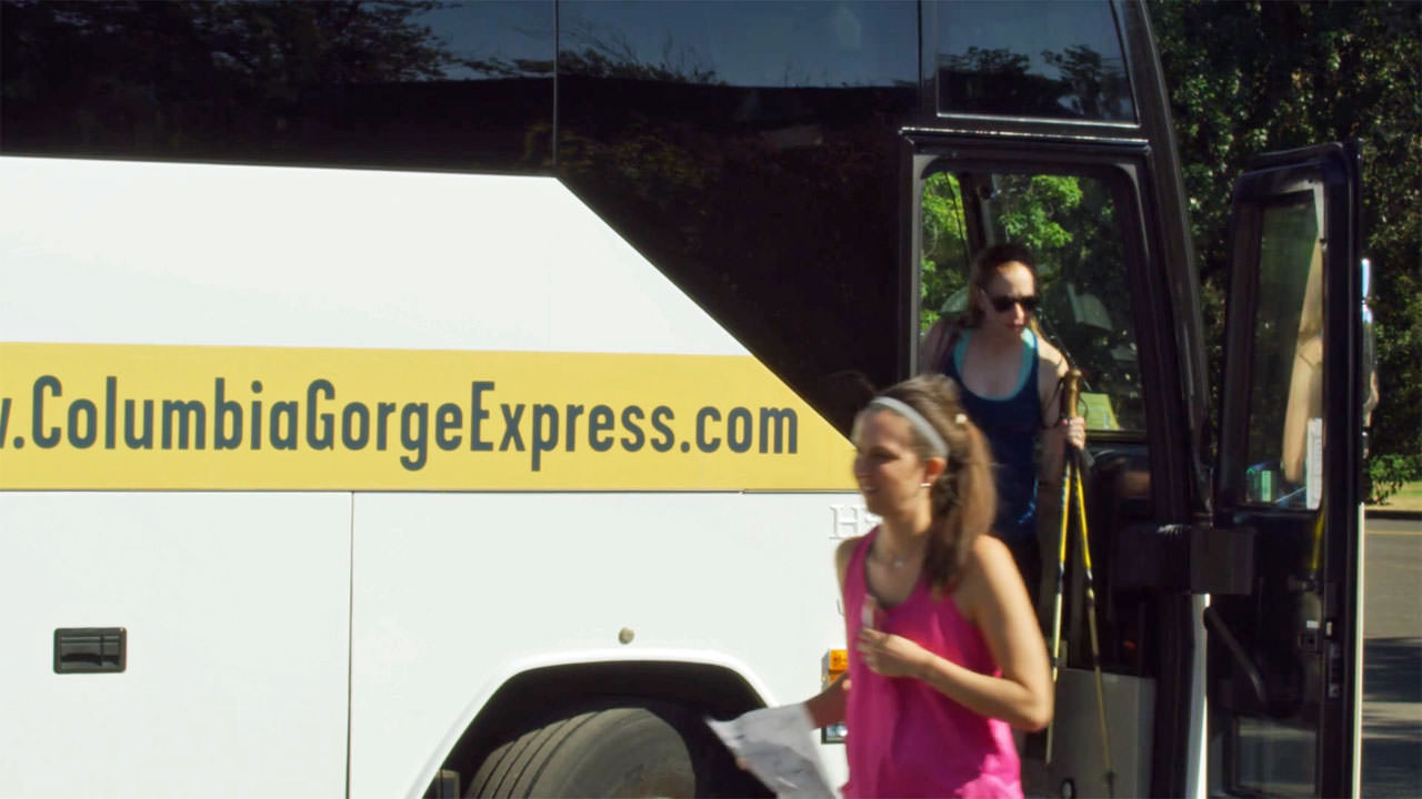 Hikers walk off the luxury motor coach of the Columbia Gorge Express.