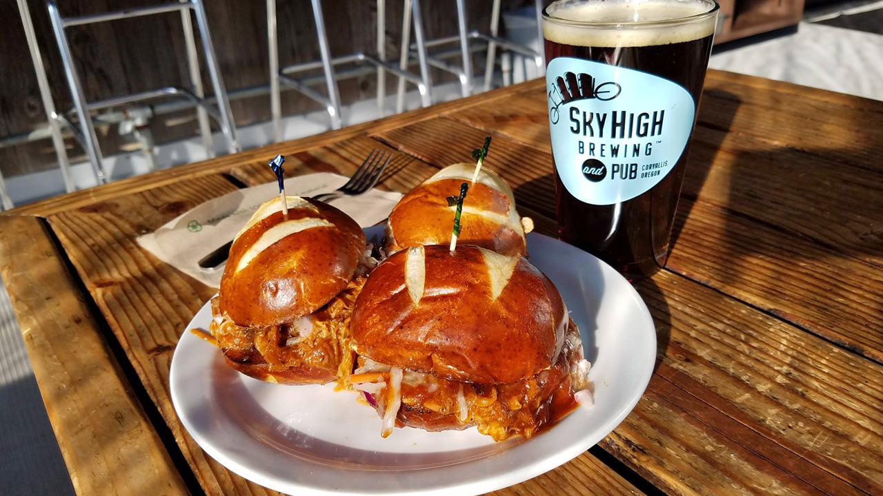 Sliders at Sky High Brewing come on large pretzel buns and just might be best with a dark craft beer.