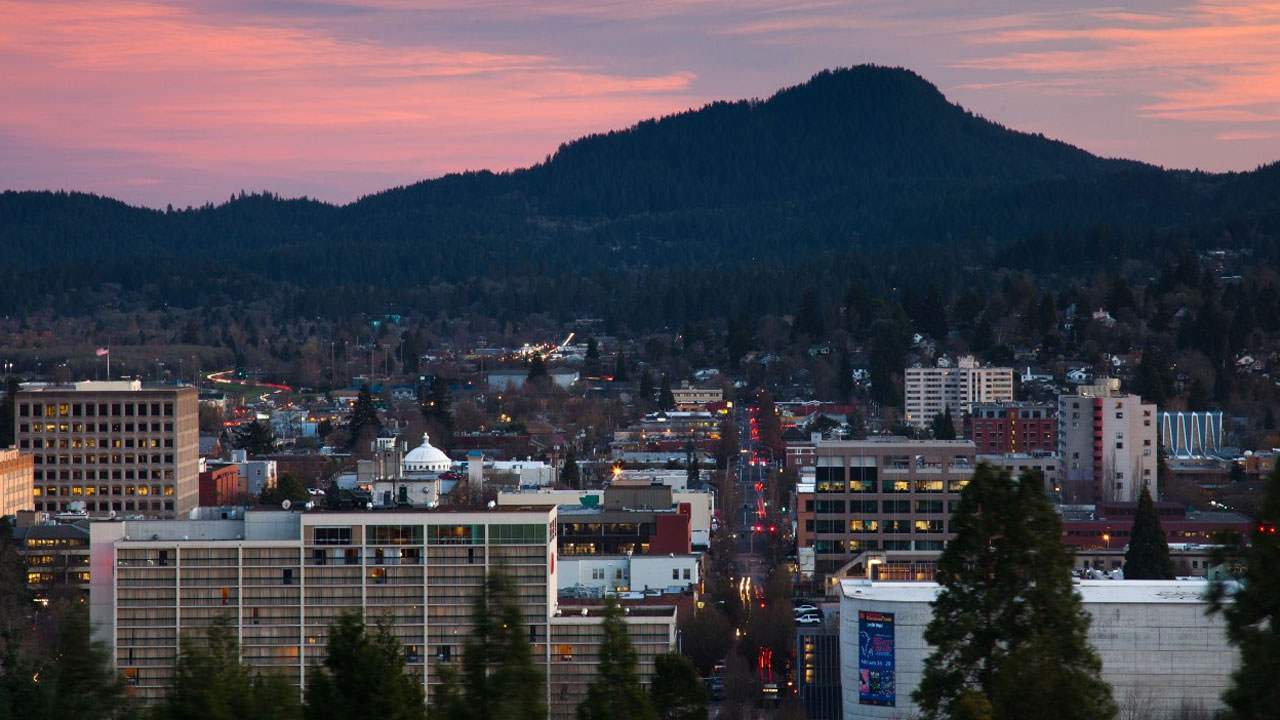 A pink sunset over downtown Eugene from Skinner Butte