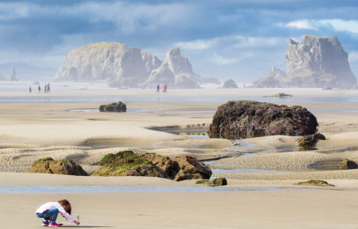 Wander the beach at Bandon, where towering rock formations and hidden agates will leave you wowed. (Photo credit: Oregon Coast Visitors Association)