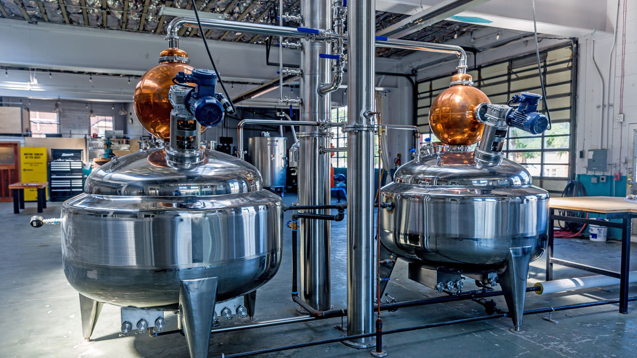The shiny metal and copper distilling equipment at Oregon Grain Growers looks fantastical.
