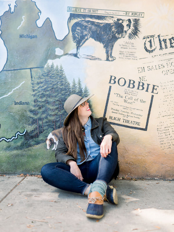 A girl looks up at the Bobbie mural.