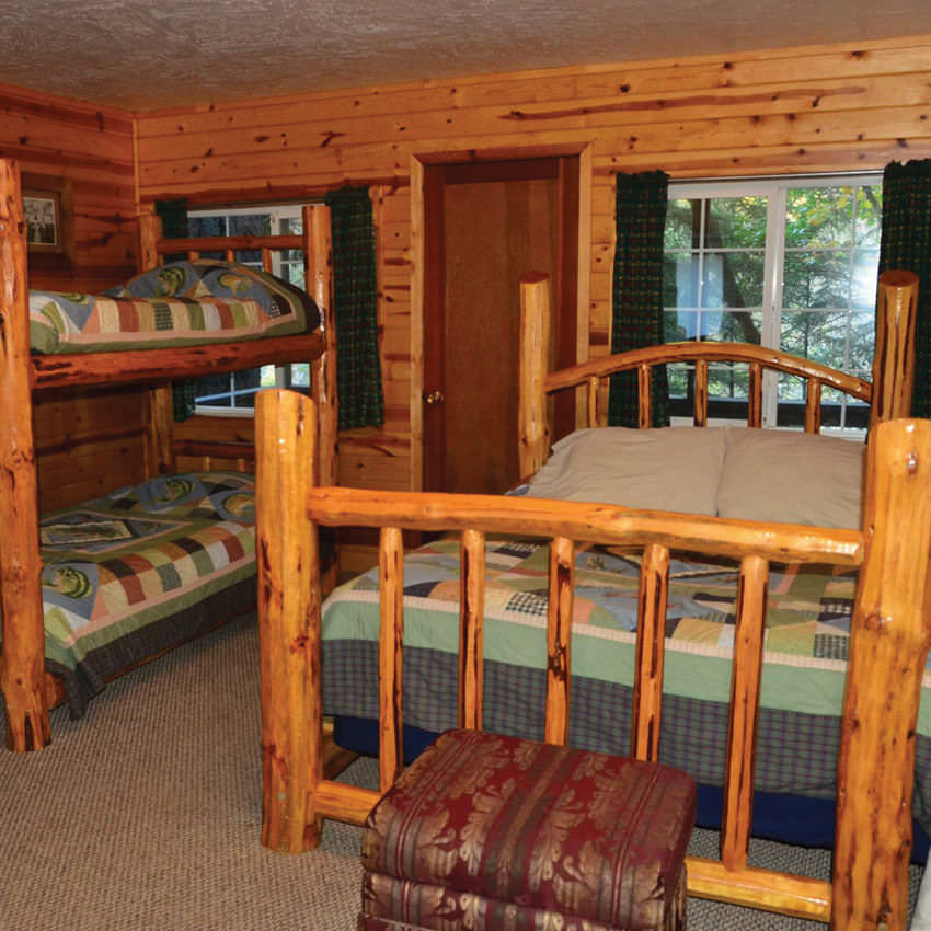 Two sets of bunk beds inside a cabin