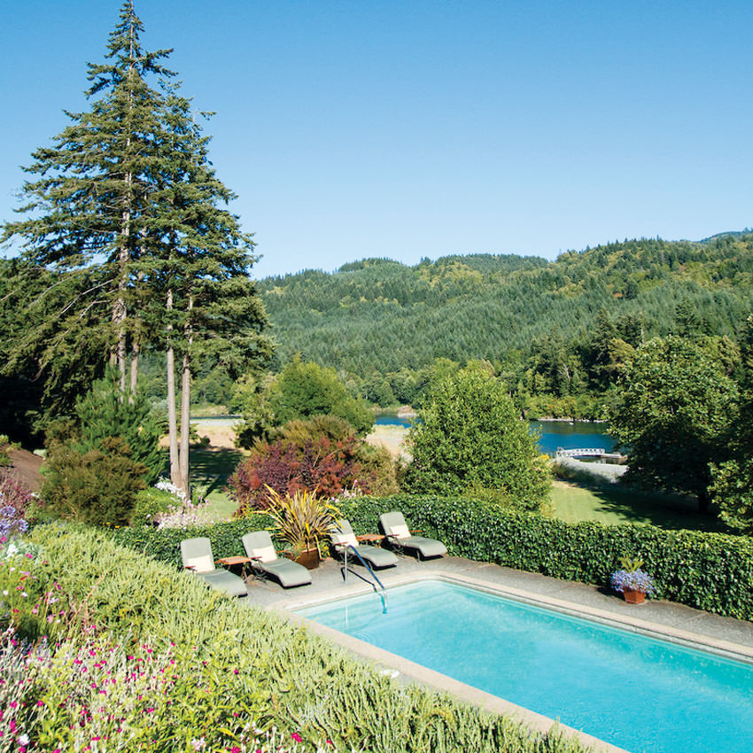 An outdoor pool sits above the Rogue River