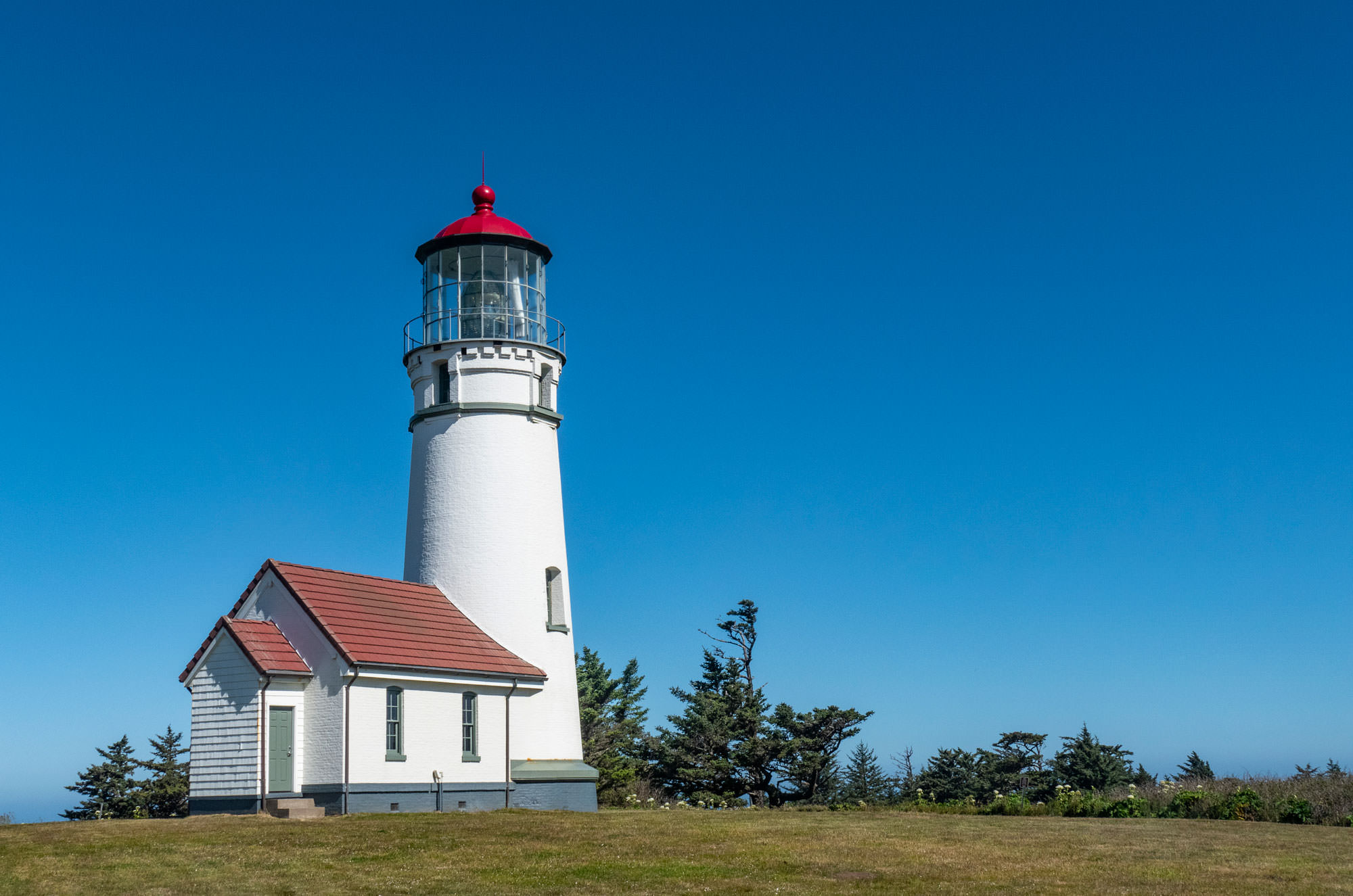 Blue skies surround the Cape Blanco lighthouse.