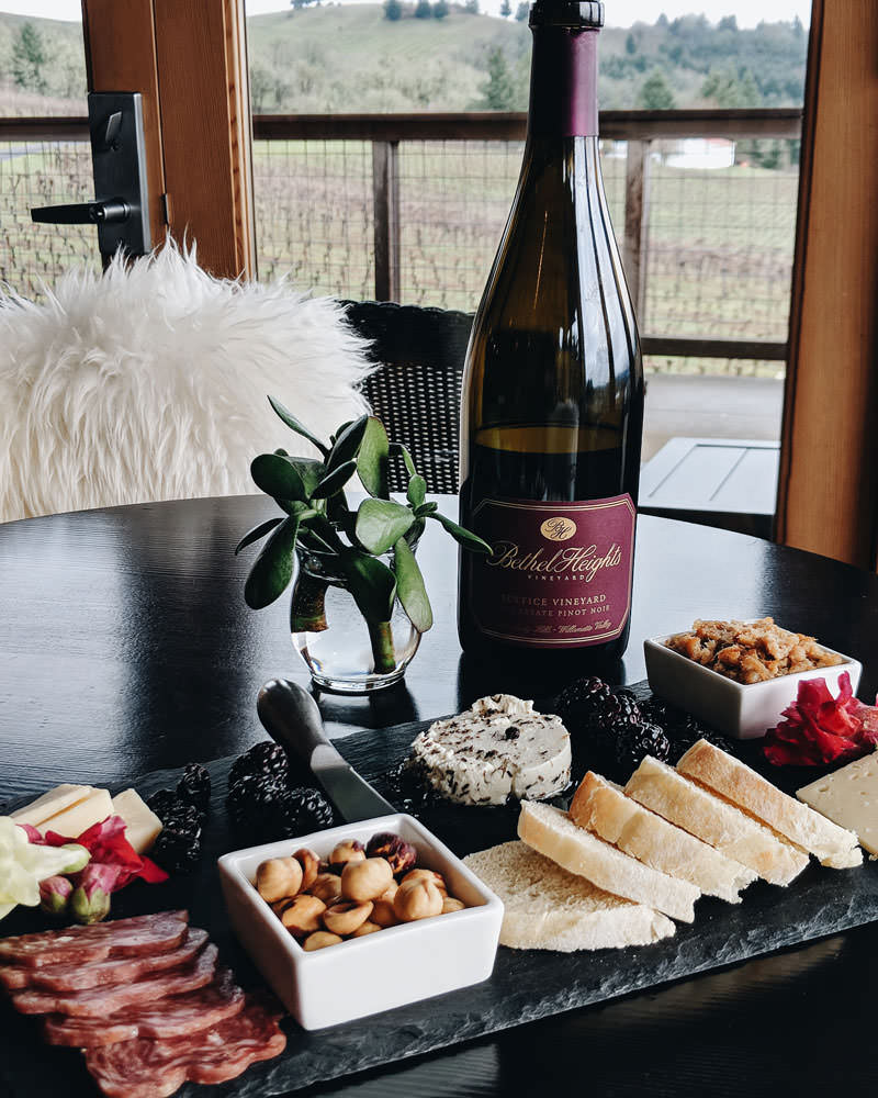Indulge in a charcuterie plate of meats, cheese, nuts and berries with wine to match.