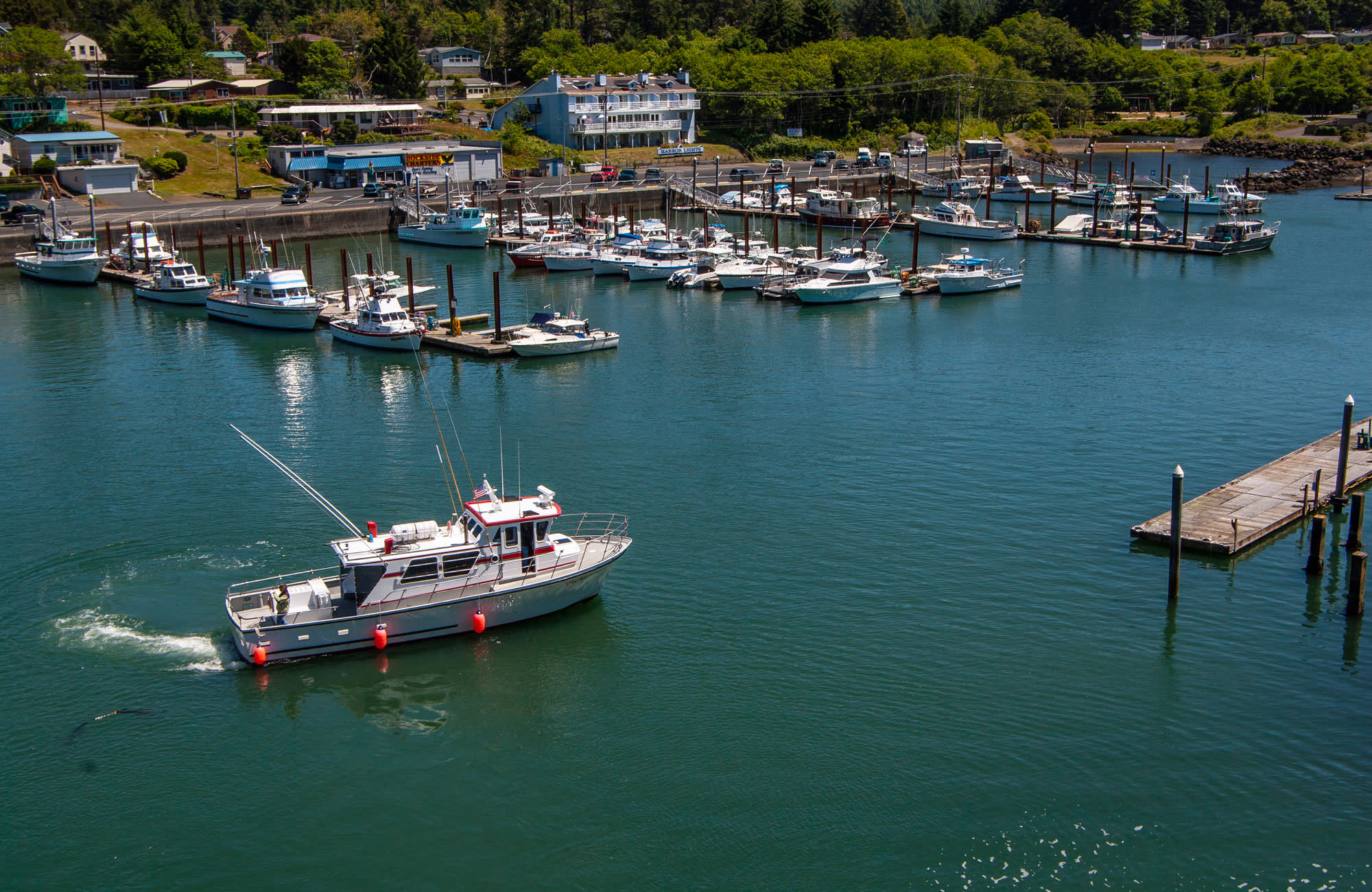 A boat moves into the small harbor of Depoe Bay.