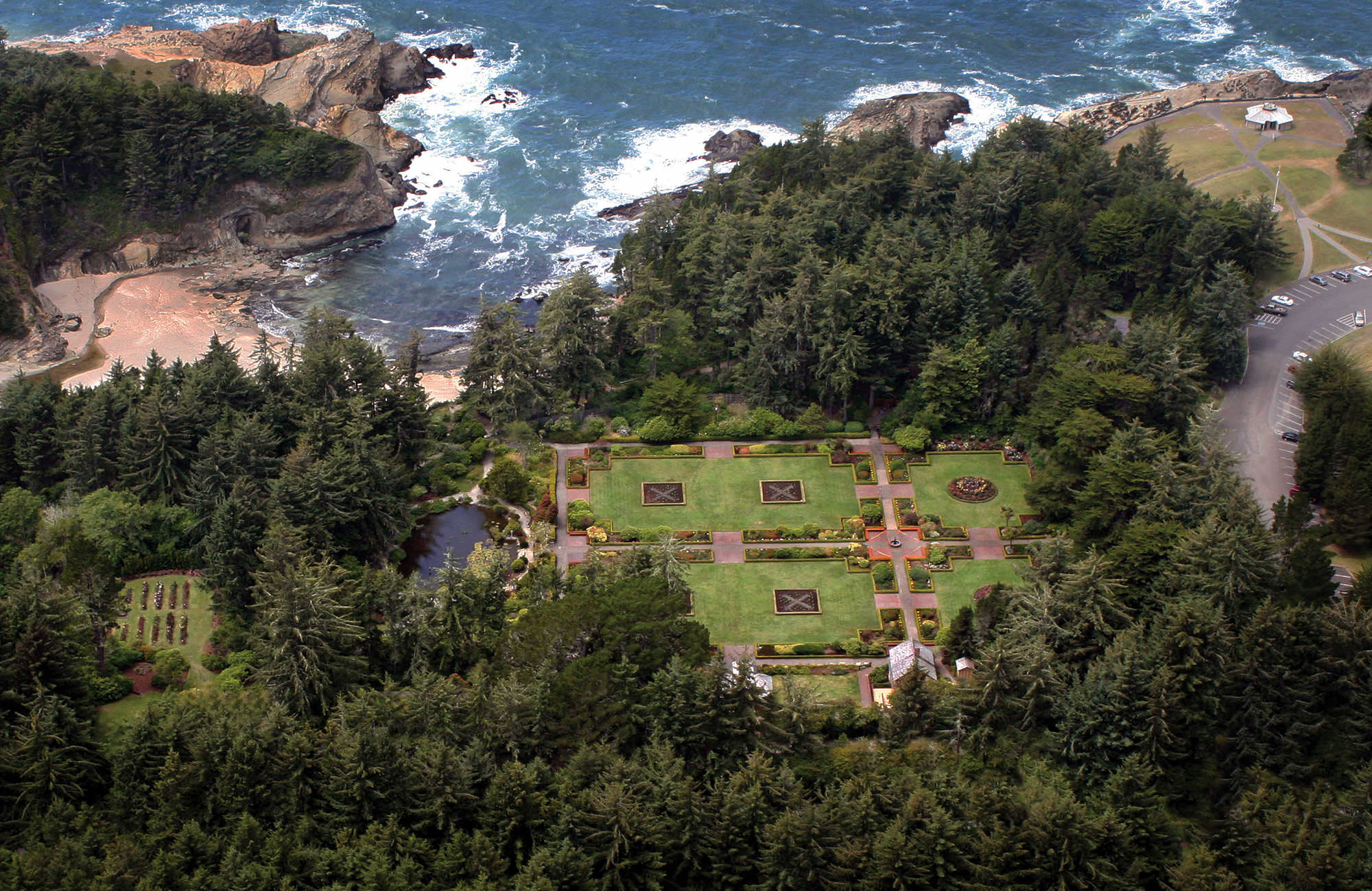 A bird's-eye view of Shore Acres State Park shows an impressive garden space on a cliff above the ocean.