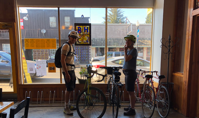 cyclists inside cafe at window