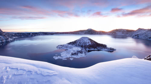 Crater Lake National Park shines in all its winter glory. Free guided snowshoe tours are a perfect way to experience it. (Photo credit: Steve Bloom Images / Alamy Stock Photo)