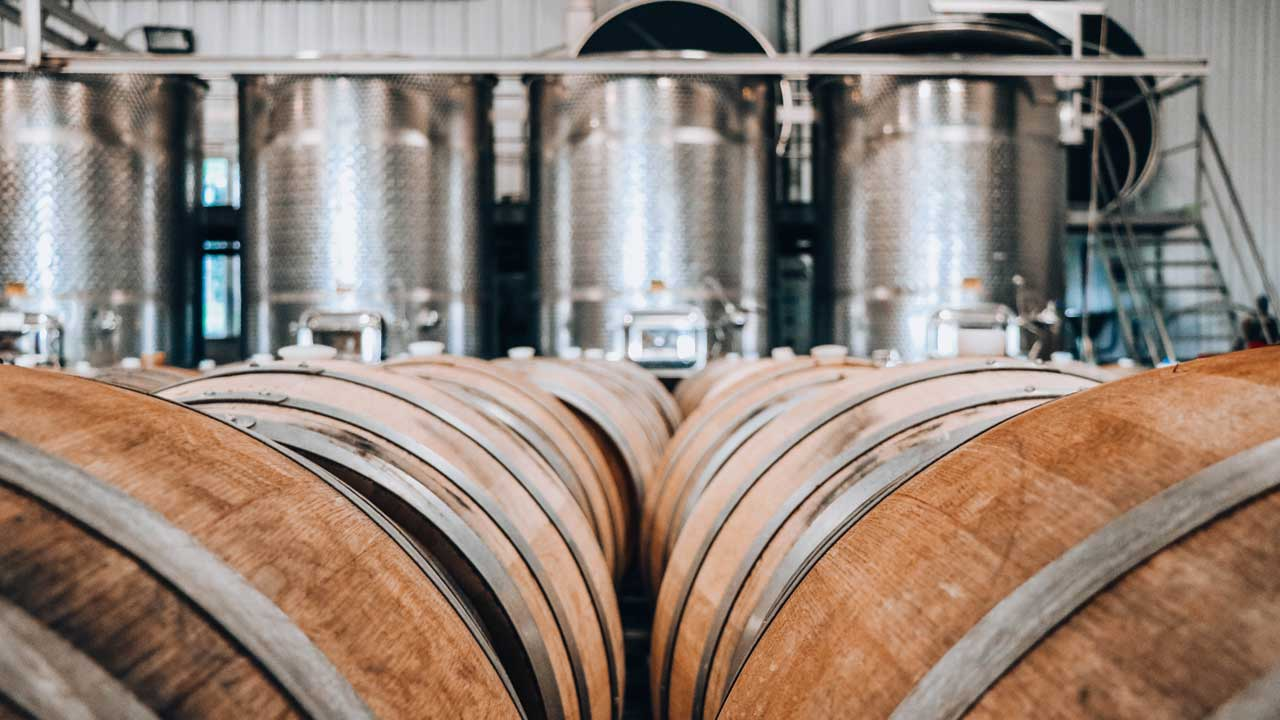 Wine barrels are lined up in an Oregon production facility.