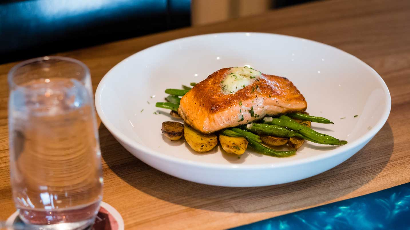 A plate of salmon, asparagus and potatoes.