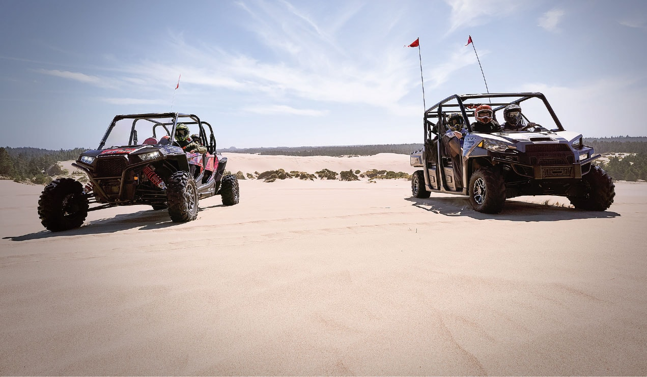 People riding ATV in the dunes