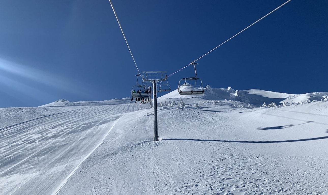 Blue skies and a snowy summit make for a skier's dream day.