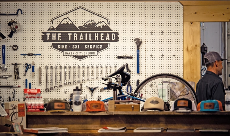 A pegboard with tools in a bicycle shop
