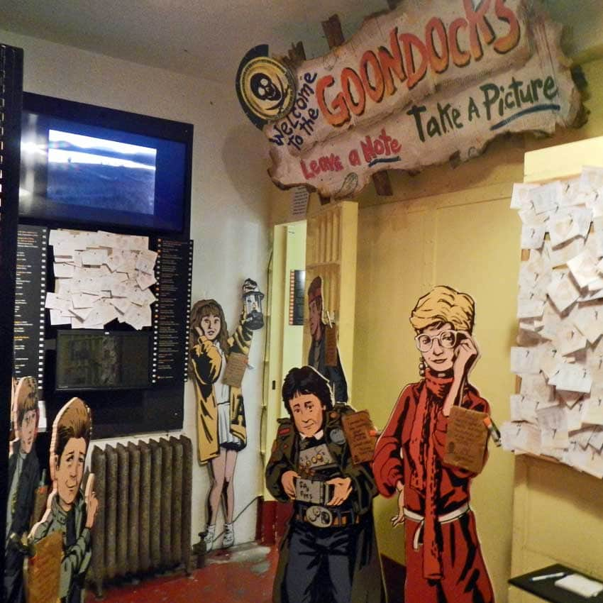 Inside the Goonies exhibit are cardboard cutouts of iconic characters.
