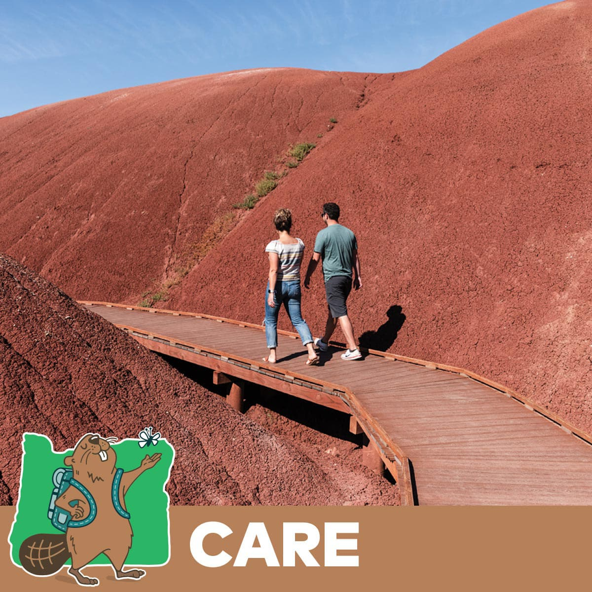 Two people walking on the path at Painted Hills