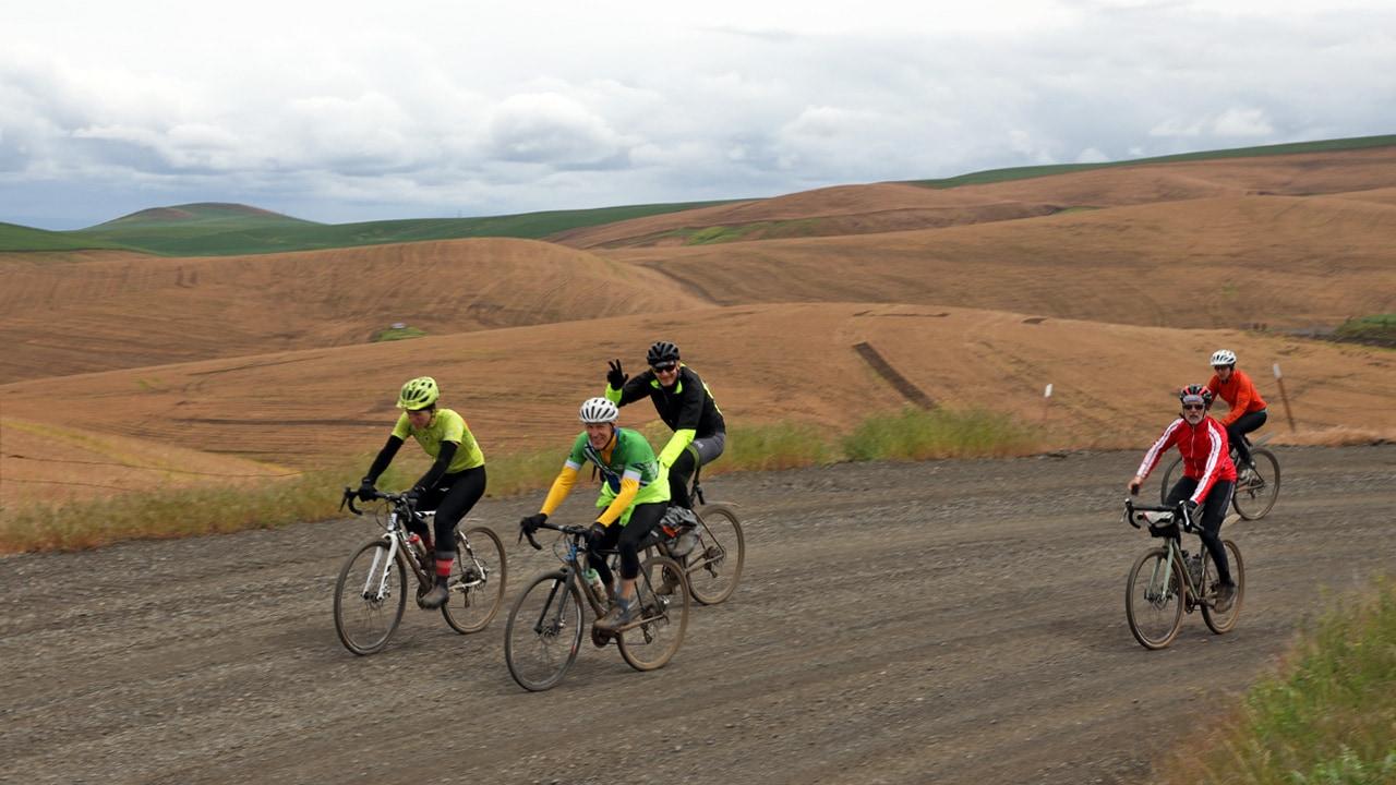 Cyclists riding through valleys