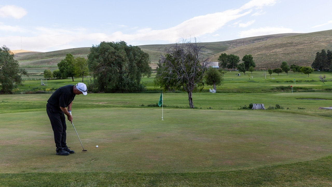 Golfer putting at Willow Creek Country Club