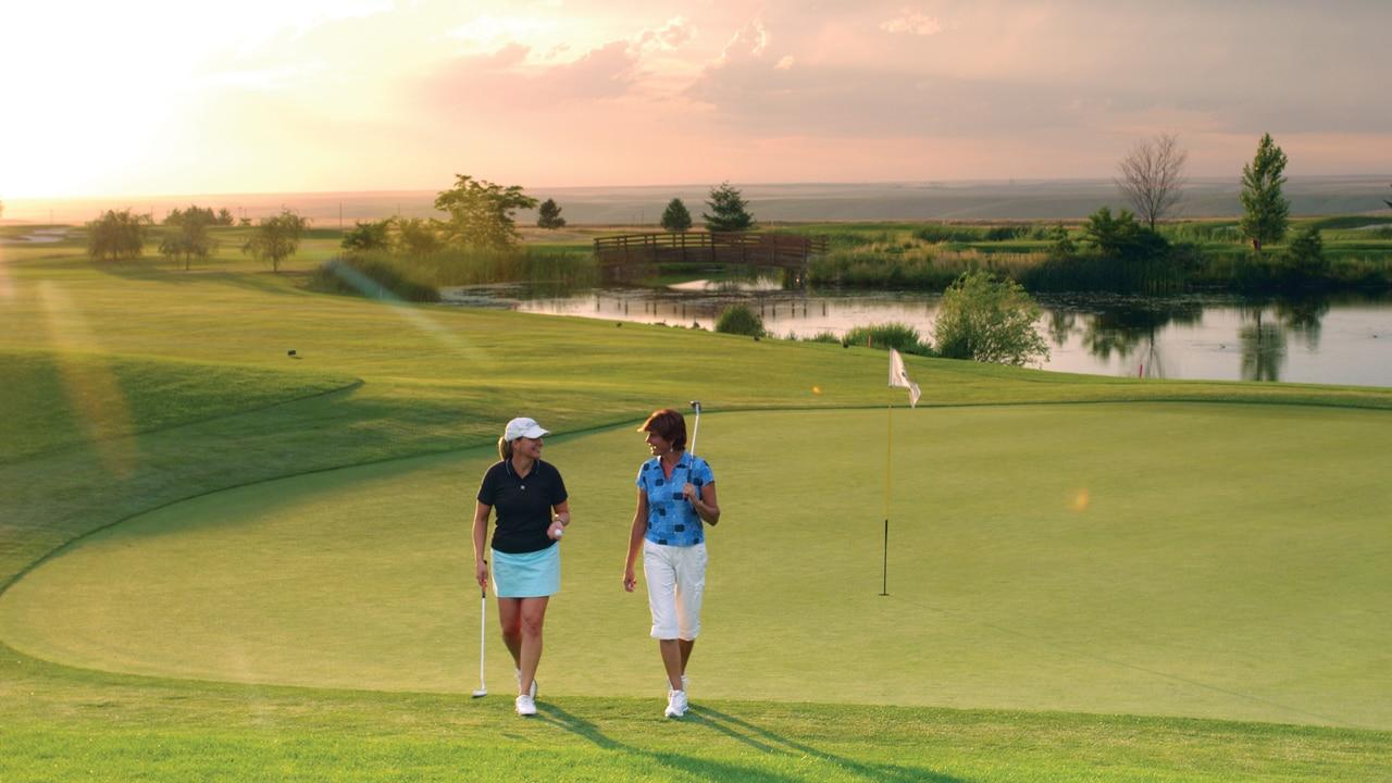 Golfers enjoying a sunset