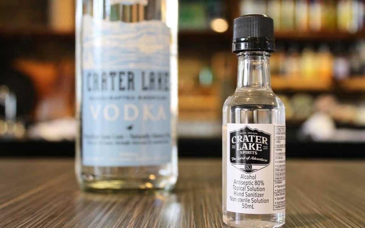 A bottle hand sanitizer sits on a bar.