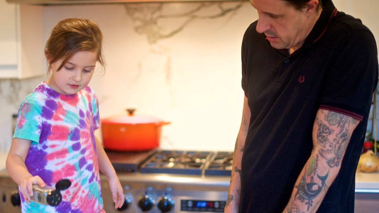 Gabriel Rucker and his daughter in a kitchen cooking